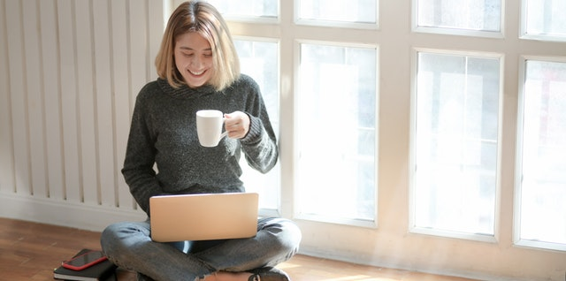 woman-in-gray-sweater-drinking-coffee-3759089.jpg